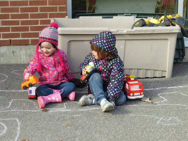 Hailey Fisher, Betty Lalonde play at one of the outside kindergarten stations (deb pic)