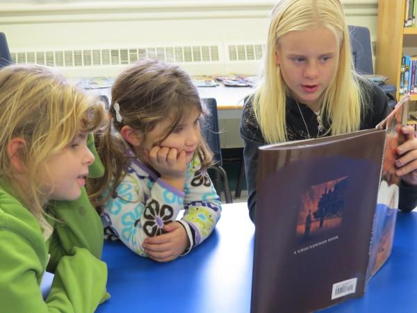 Victoria Watt-Runge reading to buddies Cheyenne Chesney and Shaelyn Lord