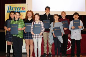 Student recipients of the Bravo Breakfast Award standing with their certificates.
