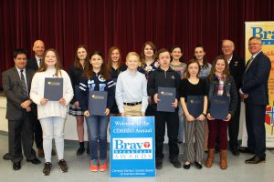 A group of students stand with their awards.