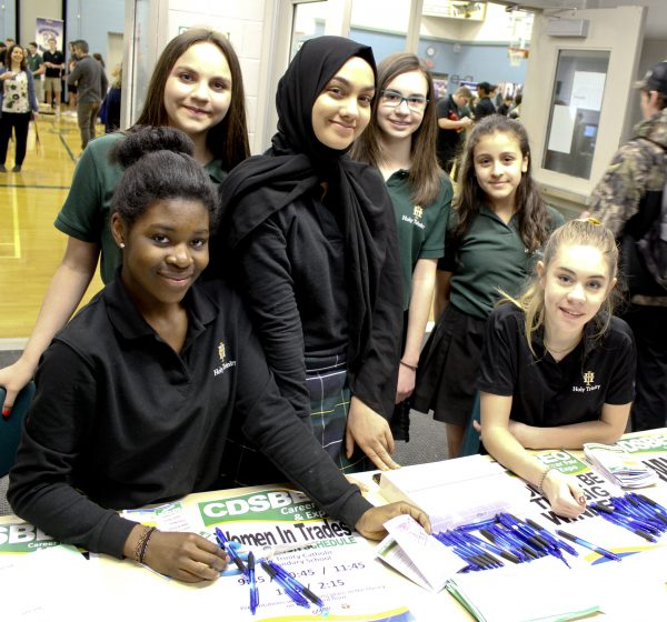 A group of students from Holy Trinity Catholic Secondary School host the Women in Trades table at the CDSBEO Career Fair in Cornwall.