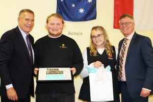 Two students present a gift to CDSBEO Board Chair Todd Lalonde and Director John Cameron.